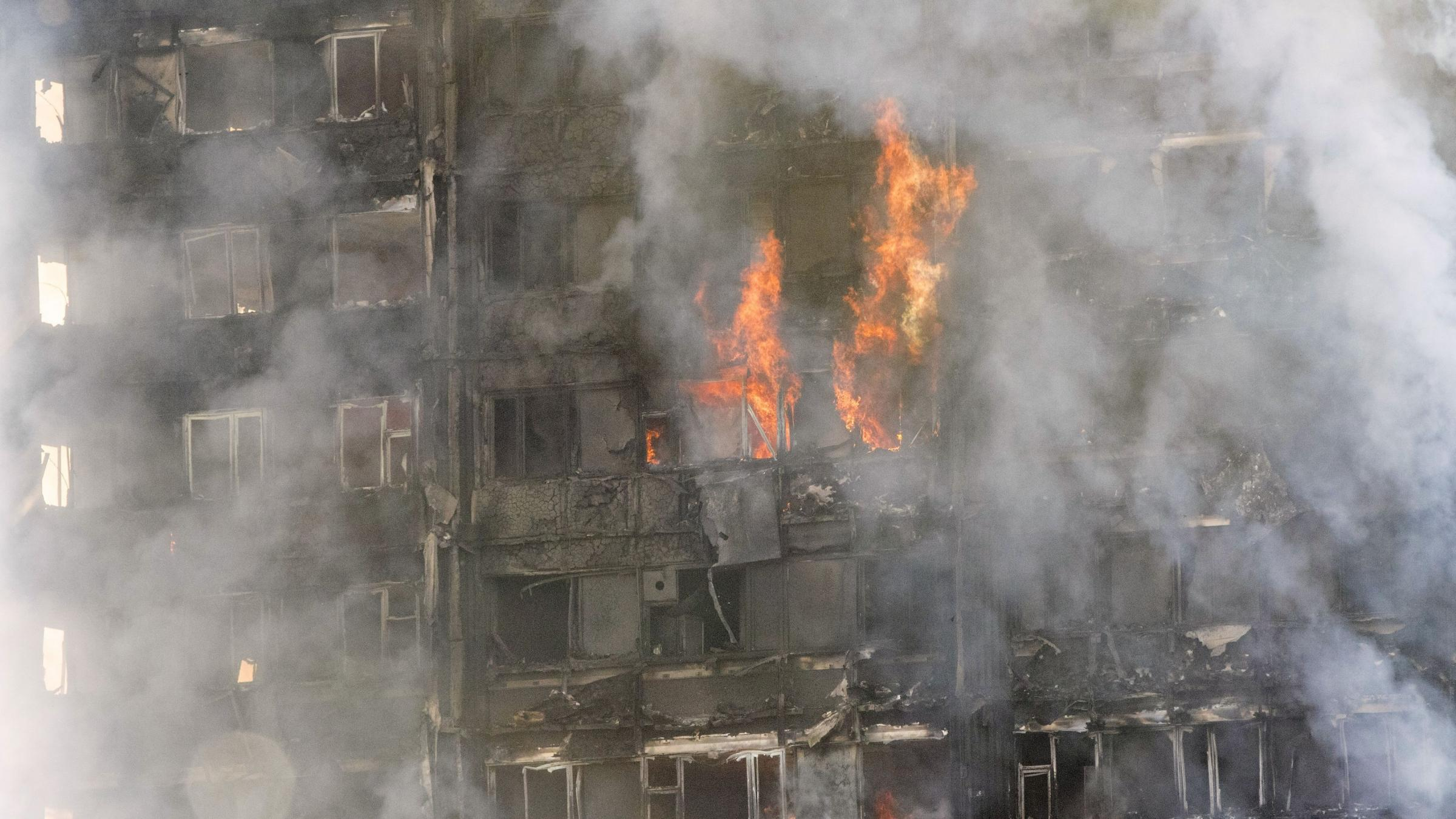 London fire: Baby caught after being 'dropped to safety from tower'